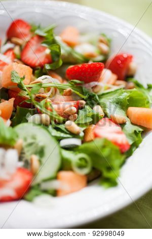 Summer salad with strawberries and cantaloupe