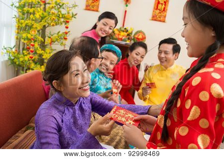 Giving A Red Envelope For Tet