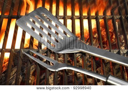 Bbq Tools On The Hot Flaming Grill