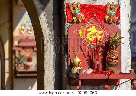 Small buddhist altar on the streets of Penang, Malaysia