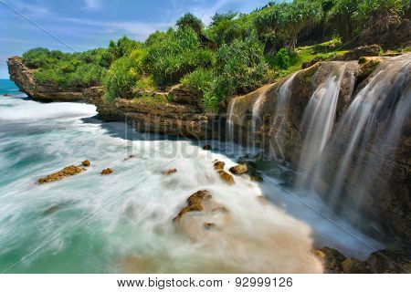 Beautiful Jogan waterfall falling to the ocean, Java, Indonesia
