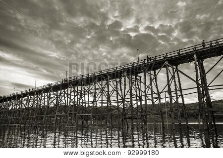 The old wooden bridge in Sangklaburi, Kanchanaburi Province, Thailand. Black and white photo.