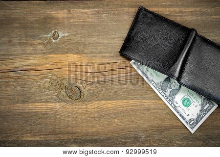 Open Male Black Leather Wallet With One Dollar Bill