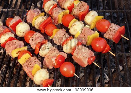 Uncooked Mixed Pork Meat And Vegetables Kebabs On The Grill