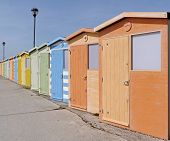 picture of beach hut  - British colourful beach huts in row at seaside - JPG
