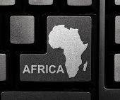 picture of continent  - Black computer key with african continent shape - JPG