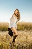 foto of tallgrass  - Sunrise shot of a beautiful model on meadow - JPG