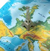 image of atlas  - Paris destination Eiffel Tower icon on geographical map Travel concept - JPG