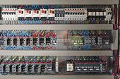 stock photo of contactor  - Electrical panel at a assembly line factory - JPG