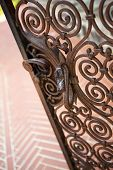 stock photo of wrought iron  - Close up of a stylish wrought iron gate - JPG