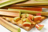 pic of cut  - detail of fresh cut rhubarb on wooden cutting board - JPG