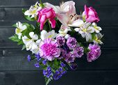foto of carnation  - Colorful bouquet of flowers roses lilies carnations - JPG