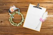 stock photo of headband  - Wooden Clipboard attach planning paper with pen on top beside rose headband tiara for bridesmaids - JPG