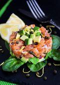 picture of tartar  - Tasty salmon and avocado tartar dark background - JPG