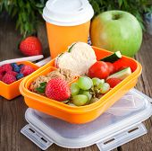 picture of lunch box  - Lunch box for kids with sandwich cookies fresh veggies and fruits - JPG