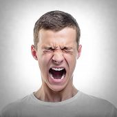stock photo of angry man  - Portrait of young angry man - JPG