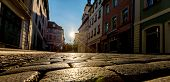 stock photo of paving stone  - Sunrise in a city street with paving stones - JPG