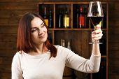 foto of wine cellar  - Young woman tasting wine in cellar - JPG