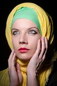 stock photo of burka  - Serious woman wearing colourful headscarf - JPG
