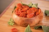 picture of apricot  - Dried apricots in a wooden bowl - JPG