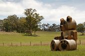 stock photo of haystack  - A giant teddy bear haystack in the field - JPG
