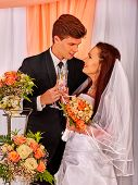 picture of banquet  - Couple at wedding table and cake in banquet room - JPG