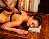 foto of panchakarma  - Young woman having spa massage - JPG