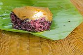 foto of custard  - Black Sticky rice with custard wrapped in banana leaves - JPG