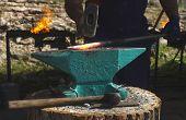 stock photo of blacksmith shop  - Blacksmith forges iron on anvil - JPG