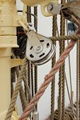 stock photo of rig  - Closeup of old metal block and rigging at the yacht - JPG