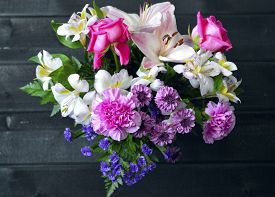 pic of carnation  - Colorful bouquet of flowers roses lilies carnations - JPG