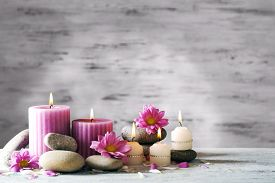 picture of stone-therapy  - Beautiful composition with candles and spa stones on wooden background - JPG