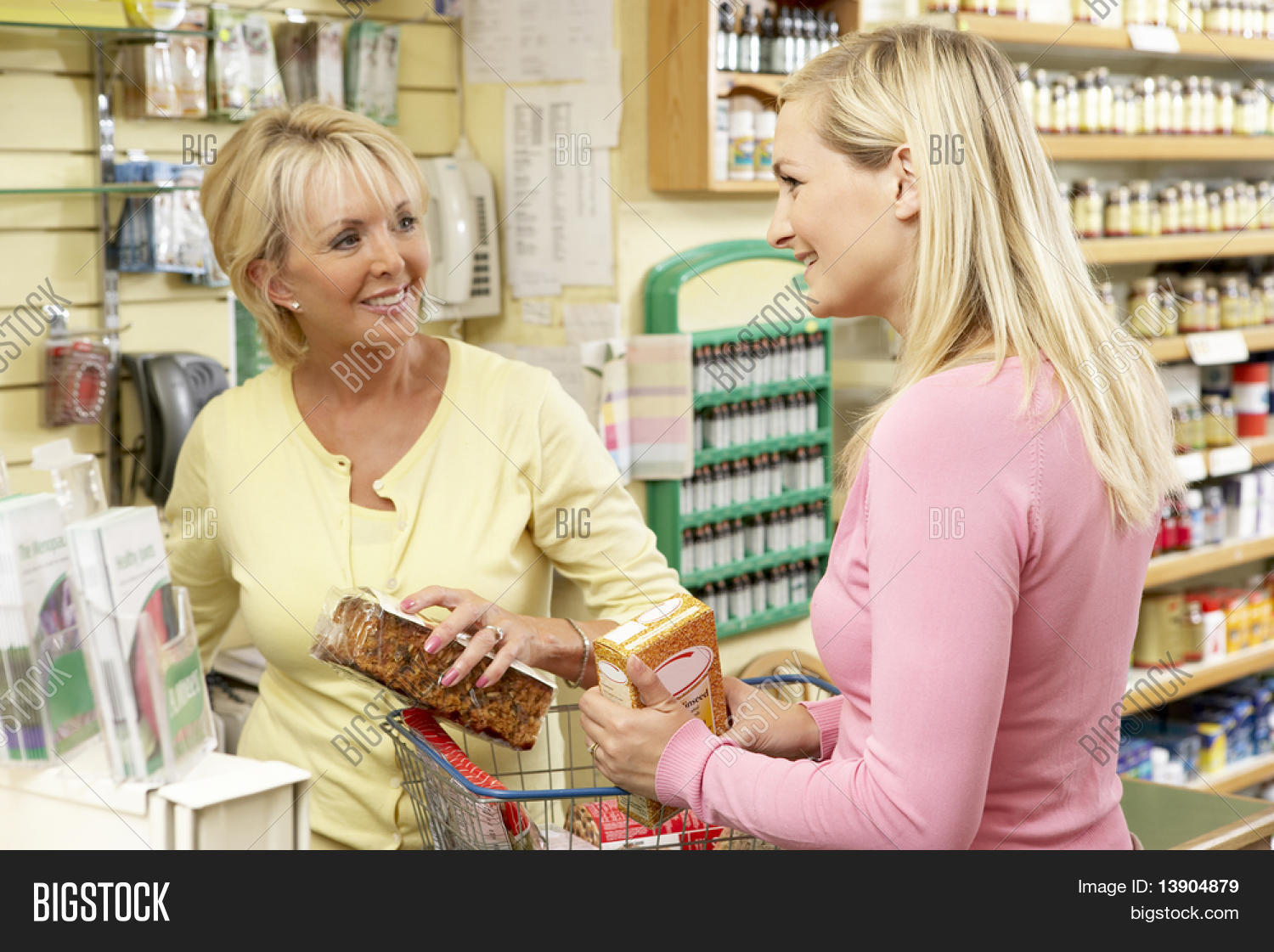 Sales assistant with customer in health food store stock for Assistant cuisine
