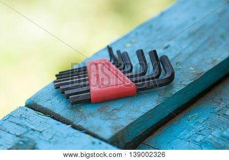 tool renovation on blue wood background. Blurred background.