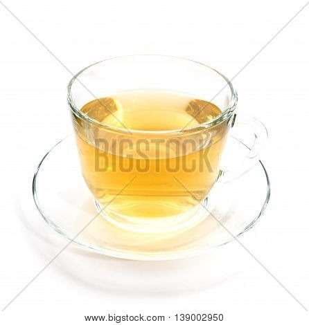 Transparent cup of green or chamomile tea on white background