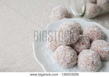 Homemade Strawberry, Date, Cashew And Coconut Bliss Ball On Vintage Plate