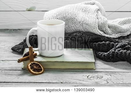 Cup Of Tea On A Beautiful Wooden Background With Winter Sweater, Old Book