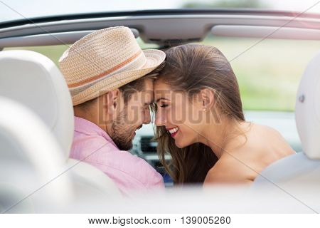 Couple enjoying a drive in a convertible