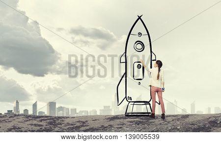 Girl drawing rocket . Mixed media