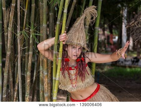 Girl wearing Africa clothes for the African Party near Huts