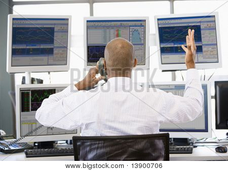 Stock Trader Talking Animatedly On The Phone