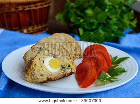 Meatloaf with mushrooms and boiled egg. Close up