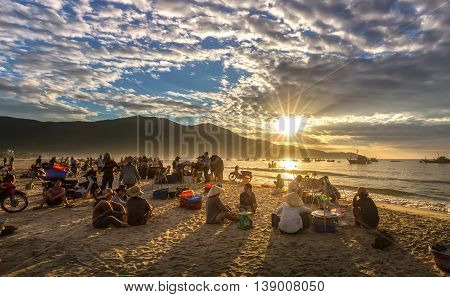 Da Nang, Vietnam, June 26th, 2015: Market early fishing village when people busy buying selling fish, transport fish to markets, sun rays radiating prepared atmosphere very lively, all living life