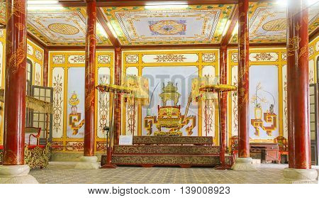Hue, Vietnam - July 16th, 2011: Palace of Forbidden City in Hue with palatial architecture red lacquer trimmed with gold, center throne king reigns when assembly sat court represents power feudal state. It recognized national cultural heritage