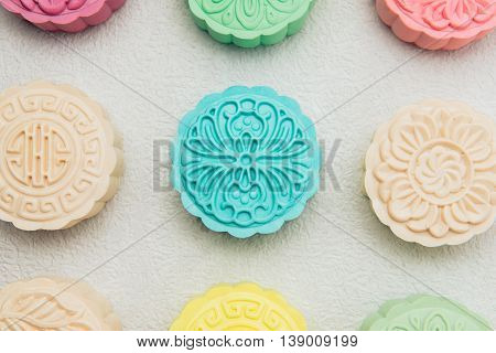 Snowy skin mooncakes. Chinese mid autumn festival foods. Traditional mooncakes on table