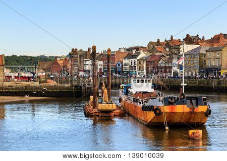 WHITBY ENGLAND - JULY 16: A large yellow trawler boat within the harbour. In Whitby North Yorkshire England. On 16th July 2016.