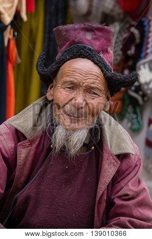 LEH INDIA - JUNE 24 2015: Unidentified tibetan old man on the street in Leh Ladakh.