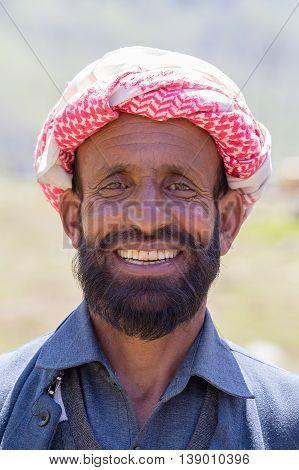 SRINAGAR INDIA - JUNE 12 2015: Unidentified Indian muslim man in the street market