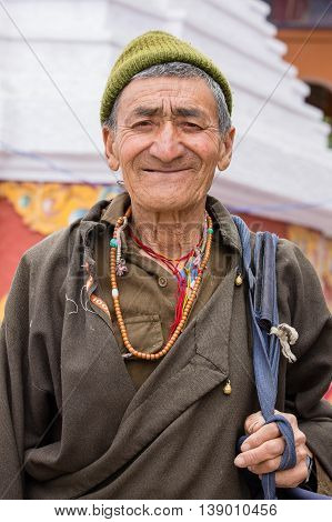 LEH INDIA - JUNE 21 2015: Unidentified beggar man on the street in Leh Ladakh. Poverty is a major issue in India