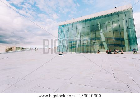 Oslo Norway - July 31 2014: People walking on the roof of The Oslo Opera House Is The Home Of The Norwegian National Opera And Ballet